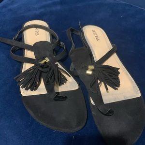 Black sandals with tassels